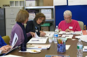 Familiarizing themselves with ULA's adult learning materials are (L-R) Sandy Perna, Jackie Schechter, and Rachel Pollan.