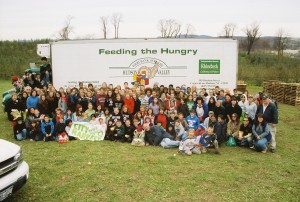 300 people showed up to harvest for the hungry. We picked 62 bins of apples on Veterans Day 2009. . .roughly 62,000 lbs! 