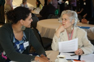 Stiles Najac, Food Security Coordinator for Cornell Cooperative Extension, and Doris Weber, Family of Woodstock, share ideas on fostering volunteerism during the UlsterCorps Service Summit. Photo: Nicci Cagan, From the Ground Up