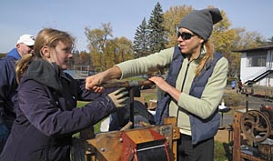 Pressing apples gleaned by SUNY New Paltz Students at Little Dog Orchard into cider for local food pantries and soup kitchens