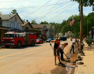 Shandaken Phoenicia Rotary Civil Emergency Response Team Clean Up Volunteers shoveling river sand out of the streets of Phoenicia between storms Labor Day weekend to prevent sand from clogging drains. The sand was trucked to the highway department and recycled on icy winter roads.